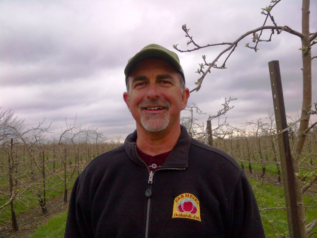 Bill Medel in his orchard