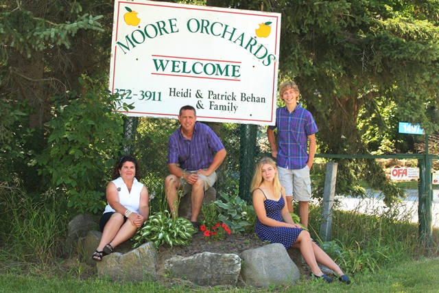 Behan Family photo with farm sign