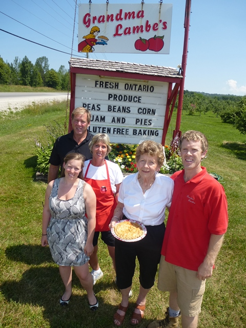 Grandma (Grace) Lambe is shown here with son Dave, daughter Darlene Smith, grandson Blake, great granddaughter Heather Smith and one of the pies she's famous for.