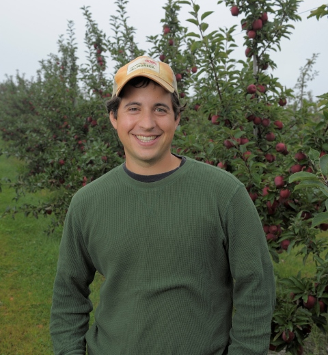 Brett Schuyler in his orchard