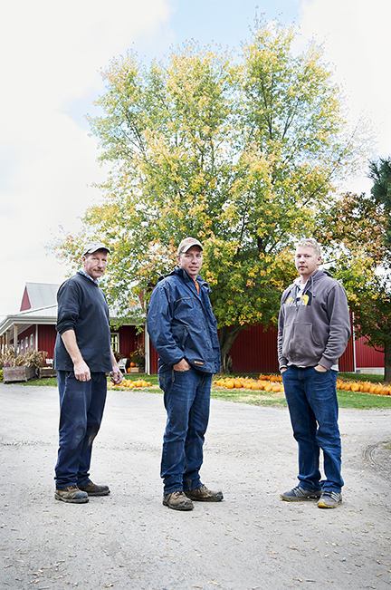 Leo, Dan and Mark DeVries on their family fruit farm