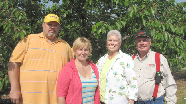 Mark, Barb, Marilyn and Hector Delanghe pose in front of sweet cherry trees on their farm, Delhaven Orchards, near Cedar Springs. The family-run business was named the Chatham-Kent feature industry of the month for June. (Blair Andrews/Postmedia Network)